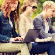 A group of people looking at a laptop